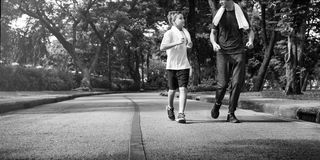 Conceito da saúde de Exercise Jogging Running do instrutor Imagem de Stock Royalty Free