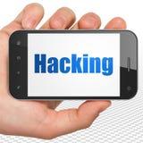 Conceito da segurança: Mão que guarda Smartphone com corte na exposição Imagem de Stock Royalty Free