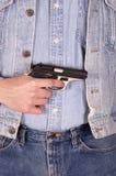 Conceito da violência armada, revólver, homem com injetor fotos de stock