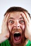 Conceito da vitória - grito do homem espantado feliz Fotos de Stock Royalty Free