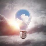 Conceito das inovações de Eco por meio da ampola Fotografia de Stock Royalty Free