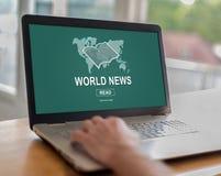 Conceito das notícias do mundo em um portátil Foto de Stock