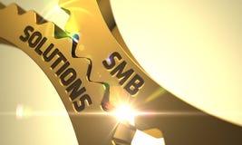 Conceito das soluções de SMB Rodas denteadas metálicas douradas 3d Imagem de Stock Royalty Free