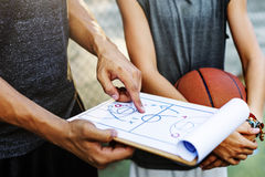 Conceito das táticas do plano do esporte do jogador de basquetebol Foto de Stock