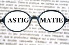 Conceito de Astigmatization no inglês fotografia de stock royalty free