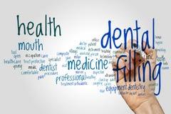 Conceito de enchimento dental da nuvem da palavra no fundo cinzento Imagens de Stock