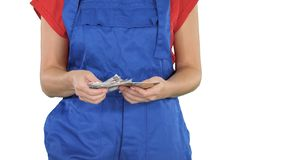 Conceito de fazer o dinheiro no comércio de construção da construção, uma mulher que conta o dinheiro no fundo branco foto de stock