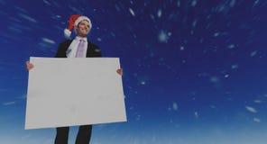 Conceito de Holding Blank Placard do homem de negócios do Natal foto de stock royalty free