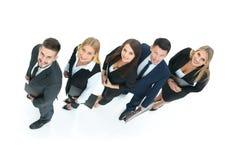 Conceito de uma equipe amigável e bem sucedida do negócio como a chave a fotos de stock royalty free