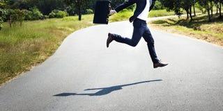 Conceito do ambiente de Running Jumping Aspirations do homem de negócios Fotografia de Stock