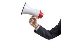 Conceito do anúncio A mão guarda o megafone Isolado no fundo branco foto de stock royalty free