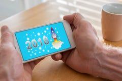 Conceito 2018 do ano novo em um smartphone Imagem de Stock