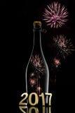 Conceito do ano novo Garrafa de vinho 2017 de Champagne no fundo preto Fotos de Stock Royalty Free