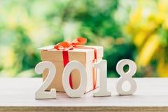 Conceito do ano novo para 2018: A madeira numera 2018 no tampo da mesa de madeira Foto de Stock