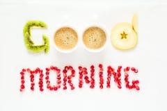 Conceito do bom dia Palavras do ` do bom dia do ` apresentadas com partes de sementes do fruto e da romã fotografia de stock