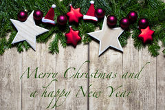 Conceito do cartão de Natal com Feliz Natal e um ano novo feliz Imagem de Stock Royalty Free