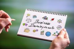 Conceito do desenvolvimento de negócios em um bloco de notas Fotos de Stock