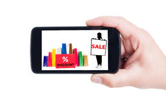 Conceito do disconto da venda da compra no smartphone Fotografia de Stock