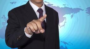 Conceito do homem de negócios que empurra a placa do toque Imagens de Stock