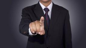 Conceito do homem de negócios que empurra a placa do toque com fundo preto Foto de Stock Royalty Free