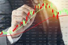 Conceito do mercado de valores de ação financeiro crescente e de queda imagem de stock