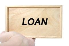 Conceito do negócio e da propaganda mão que guarda a madeira lisa com empréstimo da palavra Fotos de Stock