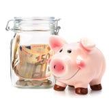 . Conceito do negócio. Economias do dinheiro no potenciômetro de vidro. Fotos de Stock