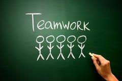 Conceito do negócio: Executivos trabalhos de equipa do ícone e do texto em chal Fotografia de Stock Royalty Free
