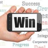 Conceito do negócio: Mão que guarda Smartphone com vitória na exposição Foto de Stock Royalty Free