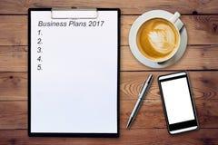 Conceito do negócio - planos de negócios 201 da escrita da prancheta da vista superior Imagens de Stock Royalty Free