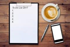 Conceito do negócio - prancheta da vista superior que escreve para fazer a lista 2017, p Foto de Stock Royalty Free