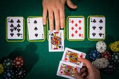 Conceito do pôquer com os cartões na tabela verde categorias da Mão-classificação: Três de um tipo Fotografia de Stock Royalty Free