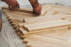 Conceito do parquet e do carpinteiro imagem de stock
