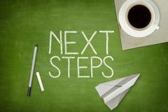 Conceito do passo seguinte no quadro-negro verde Foto de Stock Royalty Free
