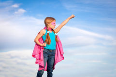 Conceito do poder da menina do super-herói Fotografia de Stock Royalty Free