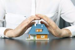 Conceito do seguro dos bens imobiliários Foto de Stock