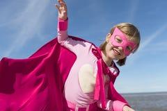 Conceito do super-herói da menina fotografia de stock