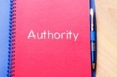 Conceito do texto da autoridade no caderno imagem de stock