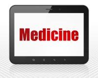 Conceito dos cuidados médicos: Computador do PC da tabuleta com medicina na exposição Foto de Stock Royalty Free