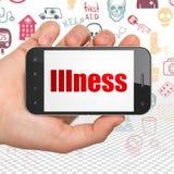 Conceito dos cuidados médicos: Mão que guarda Smartphone com doença na exposição Fotos de Stock Royalty Free