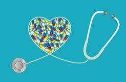 Conceito dos cuidados médicos - tabuletas e estetoscópio Imagem de Stock Royalty Free