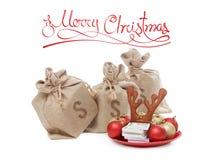 Conceito dos presentes do Natal Dinheiro, pilha da moeda usd do dólar, no fundo branco Imagem de Stock Royalty Free