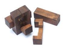 Conceito dos trabalhos de equipa do negócio: Brain Teaser de madeira ou enigmas de madeira Fotos de Stock Royalty Free