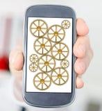 Conceito dos trabalhos de equipa em um smartphone Imagem de Stock Royalty Free