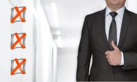 Conceito e homem de negócios da lista de verificação com polegares acima imagens de stock royalty free