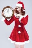 Conceito e ideias do tempo e do feriado do Natal Pulso de disparo ruivo alegre de Santa Helper With Big Round Imagem de Stock