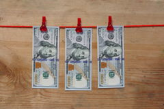 Conceito loundering do dinheiro - cem dólares - 100 dólares Fotografia de Stock Royalty Free