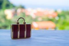 Conceito miniatural do curso da bagagem do vintage Imagens de Stock Royalty Free