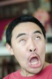 Conceito surprising da face do homem asiático fotos de stock royalty free