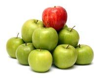Conceitos da dominação com maçãs Imagens de Stock Royalty Free